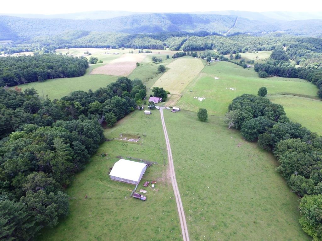 Very nice Bland farm on 190 plus acres with over 120 of it open for pasture and hay fields.The property has been farmed for generations and is ready for anyone to move in and get straight to work. Property has a pond that hasn't run dry, and a spring that flows all year. Fenced all around with separate lots for hay and cattle rotation. Multiple access points from both Flat Top Rd and Wilderness Rd. The home is a solid, well maintained 1821 sq ft and a large barn to store equipment and/or hay, several out buildings as well.  Around 70 acres of mature trees also inhabit the property. The family has taken great pride in being stewards of this land and it shows. You will not want to pass this one up in your search for farmland.Internet to be determined by buyer or buyers agent.