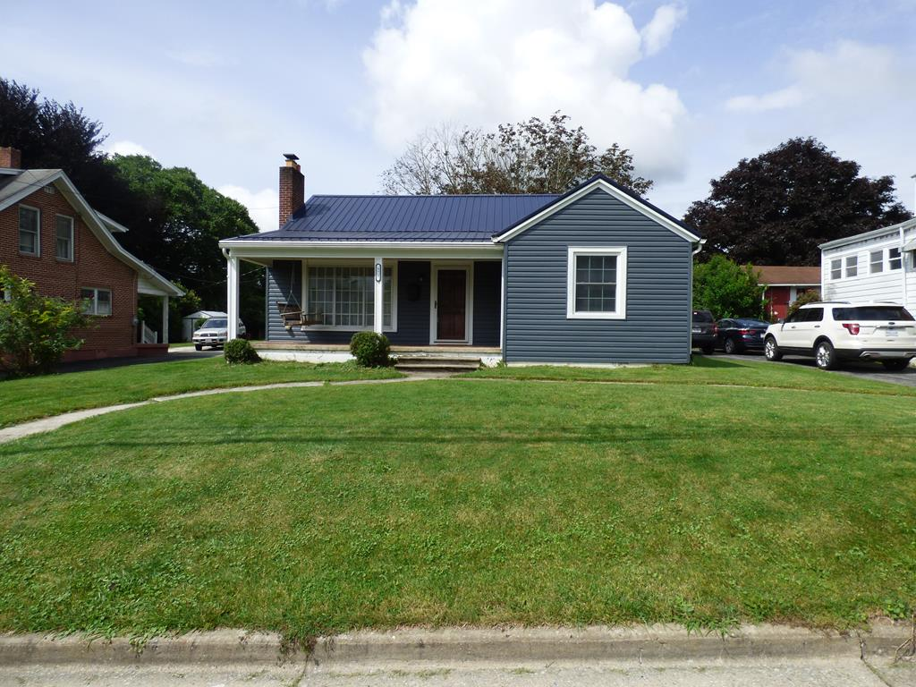 One level living within walking distance of schools and historic downtown Wytheville, Va.  This one is totally move-in ready and features beautiful hardwood floors, newer updated appliances, ceramic tile flooring in the kitchen and bath, updated wiring and plumbing throughout the entire home.  The kitchen has been updated with newer cabinets and appliances, countertops, ceramic backsplash, etc.  The living room is large and features beautiful gas logs.  Master bedroom is over 12 x 15 feet with hardwood floors.  Newer siding, new metal roof, new gutters and renovated front porch, round out the finishing touches for this lovely home. The laundry room in the basement has a fresh remodel. Its also heated with 2 Large utility sinks. Outside you will find a nice level yard with a covered front porch and in the rear, a nice covered back porch with deck.  Make your appointment today- this one will be gone soon!