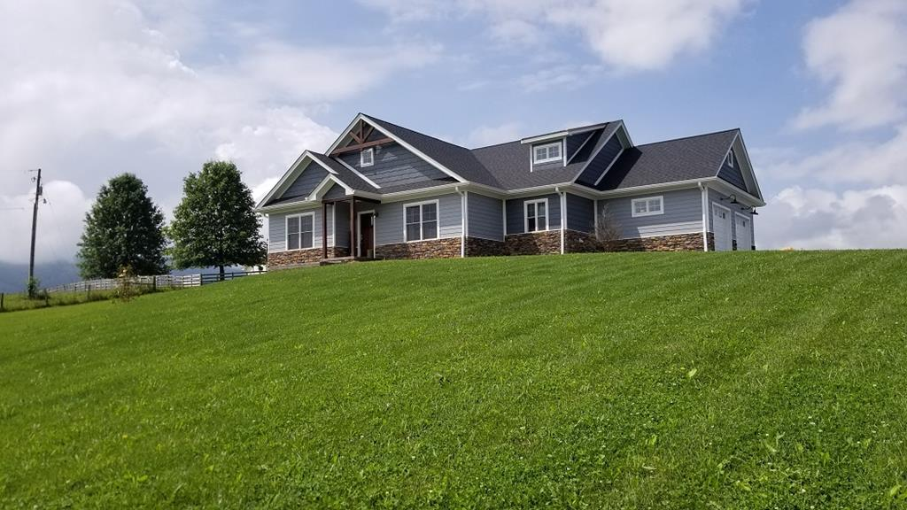 "Pristine home in  a country setting with amazing views.  Make an appointment today to tour this custom built  extra detailed, open floor plan home today.  You must see inside to appreciate the lay out and original purity. The spacious main level is  perfect for entertaining or family gathering  with 10 foot ceiling, 12' 4 ""  quartz island with bar, a stone fireplace, beautiful engineered  flooring and great sightlines.  Double Anderson french doors opens to a concrete tile screened porch. The over sized garage is  equipped with Wifi entry door openers, gladiator cabinets, a work bench. and extra storage.  Den/family room bottom level (44 X 21.4) finished  is a blank canvas to use for multi purposes with an bonus exercise room  equipped with exercise equipment, bedroom, and a safe room with steel door.   This bottom ;level would be a great place for a mother-law suite or game room.  Modern Craftsman home"