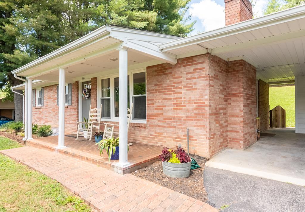 TOTALLY REMODELED  NEW ROOF, newer HEAT PUMP,  new kitchen and baths. Cozy Wood burning FIREPLACE in the living room with HARDWOOD FLOORS and updated color scheme throughout this home.  PLANK TILE FLOORING in the kitchen and STAINLESS STEEL APPLIANCES  with new  backsplash, sink, faucets and counter,.. Laundry is in the basement and the washer and dryer convey with the property, as do all the kitchen appliances too!!!. FENCED BACK YARD  for your pets or small one.  Basement is partially finished and has a wood burning fireplace for your man cave or craft room  Sit out on your patio and enjoy privacy in the City.  Close to E&H College of Health Colleges, the Lincoln Theater, Smyth Co Hospital. These owners have completely TRANSFORMED  this home for its new owners!