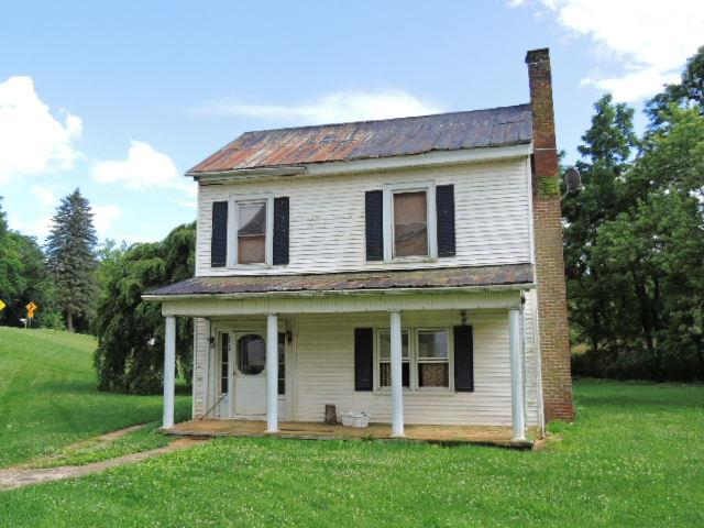1871 Farm House, Potentially 4 to 5 Bedrooms, 2,152 sq. ft. 1.7 Acres, Fireplace...and beautiful little creek with trout that runs down the side of the property. This property is sold as is.