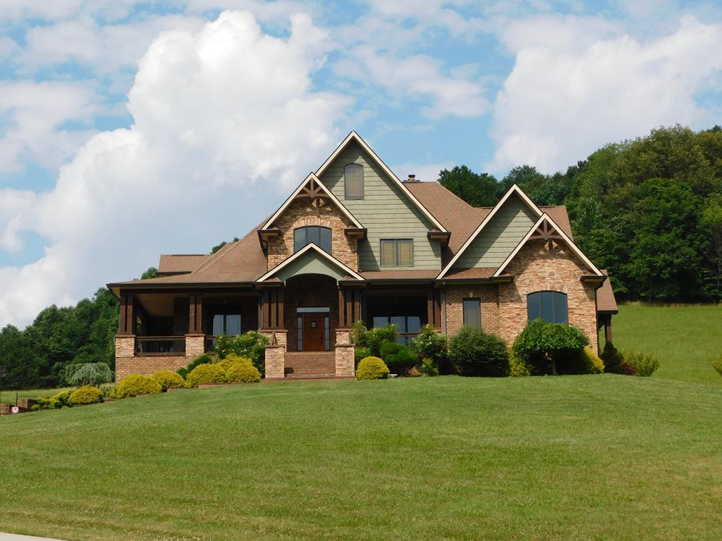 THIS IS A RARE FIND IN SOUTHWEST VIRGINIA. ITS BLENDED UNIQUE STYLE MAKES IT ONE OF A KIND. THERE ARE DIFFERENT TYPES OF WOOD, HICKORY, PINE & 70 YR OLD HEMLOCK. THERE'S ALSO STONE, BRICK, VINYL & METAL. UPON ENTERING IT WILL CAPTIVATE YOU. THE OPEN FOYER & FORMAL DINING ROOM  WITH BEAUTIFUL HEMLOCK POST IS JUST A SAMPLE OF WHAT'S TO COME. OPEN LIVING ROOM OFFERS A FLOOR TO CEILING STONE FP. THE DEN HAS EXTENDED WOOD BEAMS & STONE FIREPLACE. KITCHEN OFFERS GRANITE COUNTER TOPS, CUSTOM CABINETS W/DECORATIVE BASKET WEAVE CORBELS. CUSTOM TILE WORK THROUGHOUT. LARGE OFFICE ON MAIN LEVEL W/UNIQUE TRAY CEILING & WET BAR. SPACIOUS MASTER BEDROOM HAS TRAY CEILING AND OFFERS A LUXURIOUS MASTER BATH W/GARDEN TUB, HIS & HER VANITIES, STEP IN SHOWER AND HUGE WALK IN CLOSET. UPPER LEVEL OFFERS 3 BEDROOMS, 2 BATHS & EXTRA STORAGE. THE LOWER LEVEL, HAS FAMILY RM, 2nd KITCHEN, GAME RM, MEDIA RM & POSSIBLE 5TH BR. SITUATED ON 16 ACRES AND WITHIN 5 MINUTE DRIVE TO LAKE WITTEN. CALL FOR MORE DETAILS!