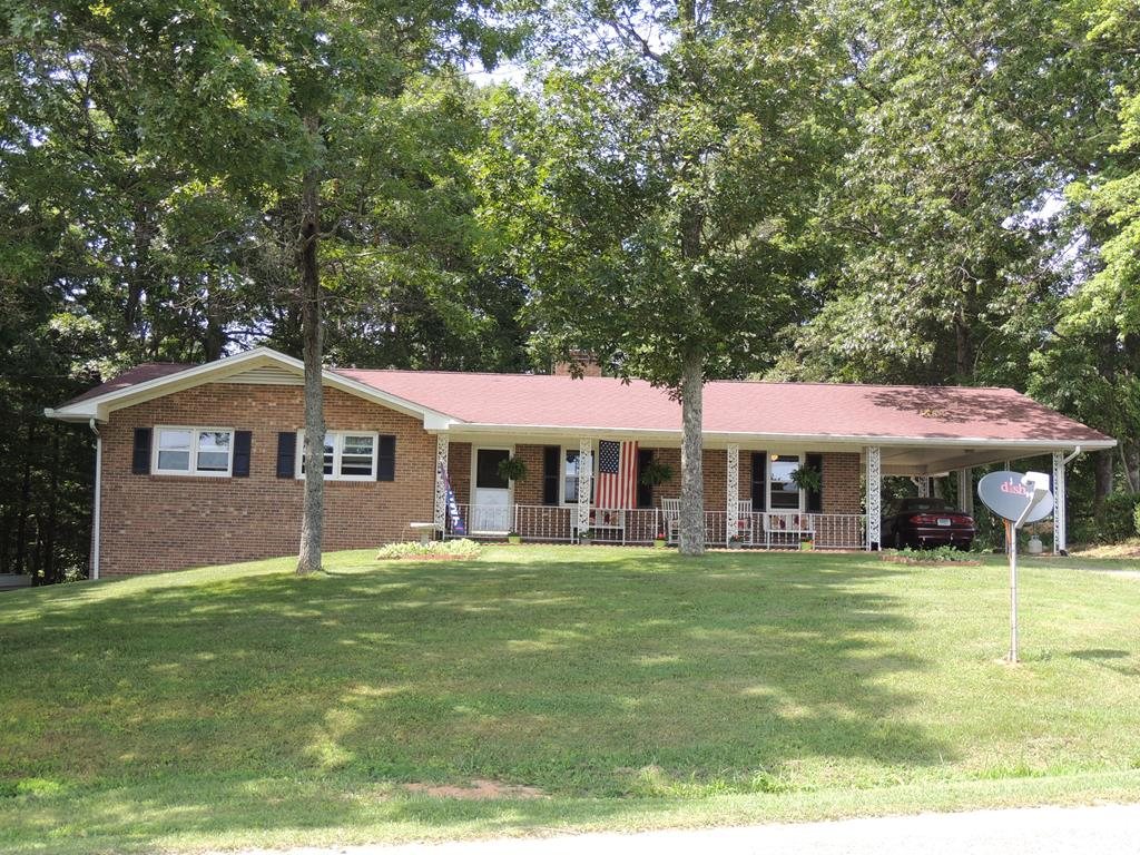This home is conveniently located near the town of Galax and is only minutes from the Blue Ridge Parkway and North Carolina. Situated on a beautiful 1+ acre tract which is mostly wooded and gives the feel of privacy and seclusion. Near shopping, eateries, hospital, doctor offices, schools, public pool , walking track, recreation center and the New River Trail. 3 bedroom, 2 baths, nice living area, oversized gorgeous sunroom which overlooks the back yard and the park like wooded setting.  If you love to cook this is a great kitchen, newly remodeled with an island, plenty of storage with lots of cabinets, pull out drawers and a nice size pantry. You can spend time talking with guest or family whether they are in the living area or sunroom and you can serve dinner from the kitchen to the sunroom which makes for easy entertaining. This property has been well taken care of and is ready to be your new home.