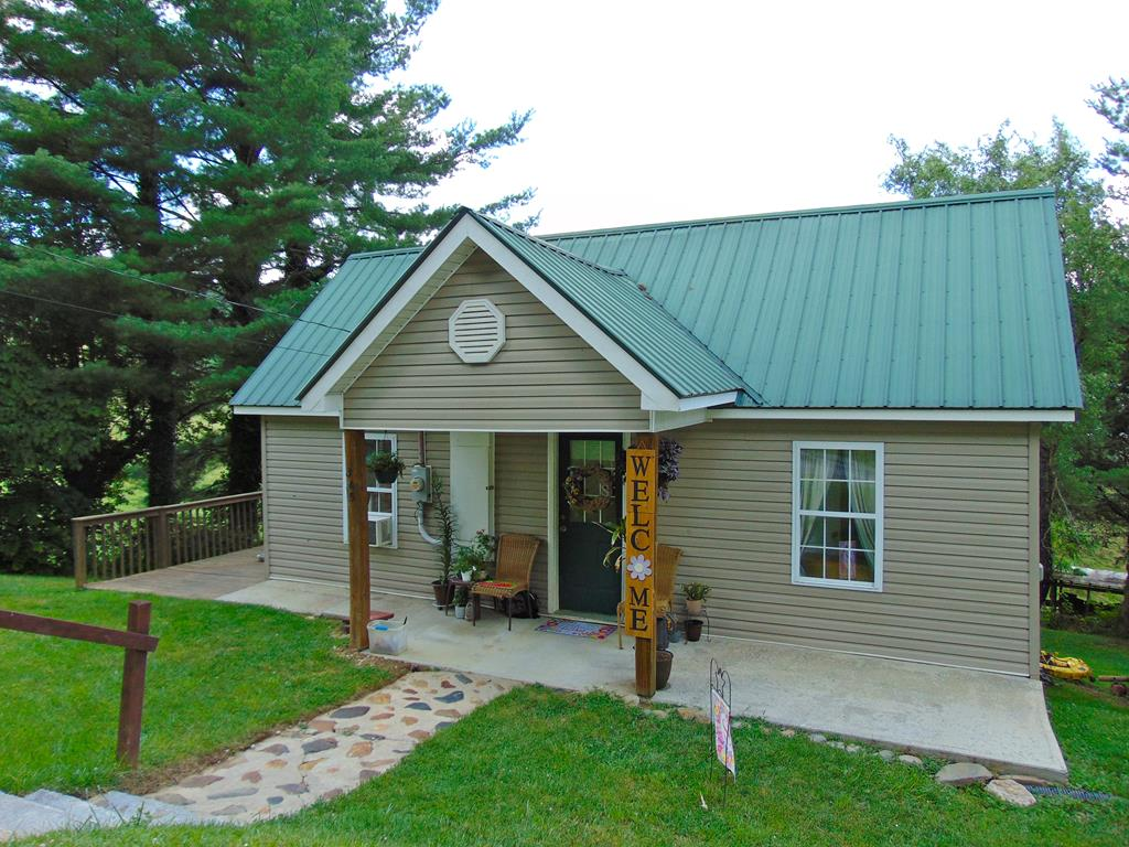 Priced to Sell!  Two bedroom one bath home just out of Galax that features replacement windows, oak cabinets, laminate flooring, all kitchen appliances stay, and a large deck!