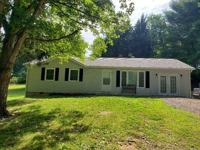 Completely remodeled vinyl sided home in Grayson County! Featuring 3 bedroom, 2 bath  with laminate flooring, living room, den and situated on a nice acre lot just outside Galax!