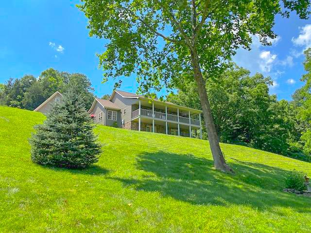Picturesque retreat nestled in the beautiful mountains of Southwest Virginia offers over 78 acres of recreational bliss! This outdoorsmen's paradise has numerous hunting spots, a bold creek for fishing and abundant wildlife throughout the property. Large buck, turkey and an occasional bear have made their home here. There's room for horses or a hobby farm in the open areas. As you travel through the gated entrance, stop for a quick hike over the stone bride to the shelter on the ridge. You'll enjoy the tranquil sounds of the creek below and take in the peaceful setting. Head over the bridge and you'll come to a charming guest house that's perfect for friends and family to gather. At the end of the drive you'll find the main house with a spacious living room, den and master suite. Quality features include hardwood and tile floors, garden tub, walk in closets and a lovely kitchen. Covered front porch an walk out basement offer park like views. Private showing, qualified buyers only.