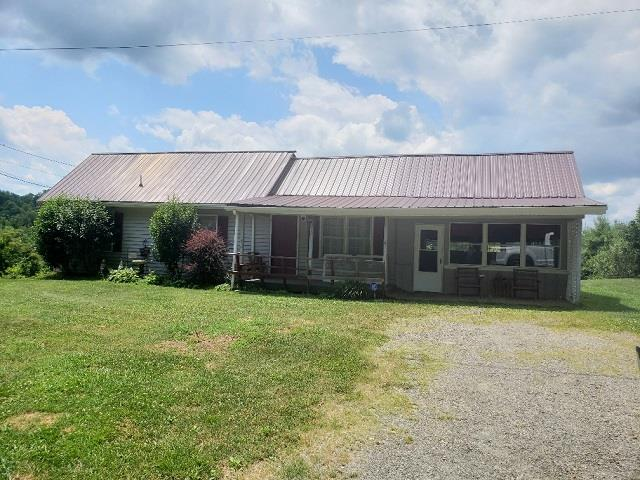 Mini Farm on 7.4 acres in Carroll County! This updated home features 3 bedrooms 1.5 bath, Large country style kitchen with lots of cabinets, tile counter tops and back splash, bar, appliances included. Newer floor covering and huge sunroom. Basement for storage with wood stove, new central air in 2019, whole house generator, Great location just outside Galax and within minutes to the New River and New River Trail. Additional 12 acres available for $34,900.