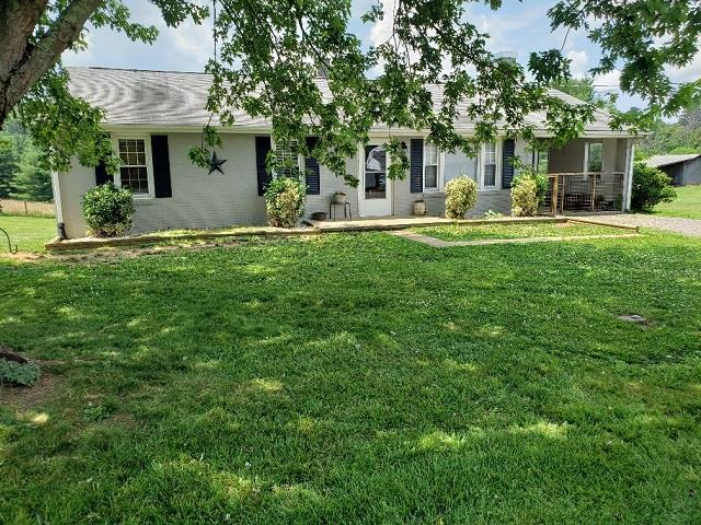 Very nice brick ranch home on a nice level lot with views of Fishers Peak and surrounding mountains. Three bedroom 1 bath with gas log fireplace, hardwood floors, and gorgeous kitchen cabinets, heat pump, carport and full basement. New outbuilding and located on a dead end street.