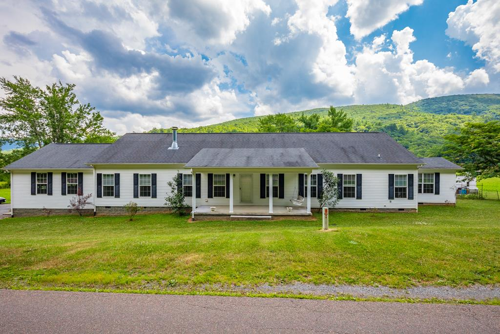 Gorgeous 3 BR 2 BA home on +/-28 acres in Bland County, VA. This property borders the Jefferson National Forest and Wolf Creek flows right through the middle of it. Great for horses, hunting, ATV riding, and more. The home was built in 2009. Very large kitchen with plenty of cabinets, a double oven, pantry, and a commercial-grade refrigerator. Entertain in front of the beautiful fireplace in the living room, which could be converted to gas if desired. The Master bedroom has its own bath and oversized walk-in closet. There is an office that could be used as a fourth bedroom if desired. Two car attached garage could also be used as a workshop. Other features include a large laundry room, a beautiful sunroom with gas logs that overlook the land, and the mountains.  security system.   There is a retractable 16' electrical awning on the back deck.  Enjoy the mountain views and the creek view from the rear deck.