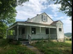 2 STORY  4 BEDROOM  1 BATH  1112 SQ. FT. HOME ON TWO LOTS AND LOCATED IN THE TOWN OF HILLSVILLE. PROPERTY FEATURES: 298 SQ. FT. WRAP AROUND COVERED PORCH, OUTBUILDING AND A FULL UNFINSHED BASEMENT.