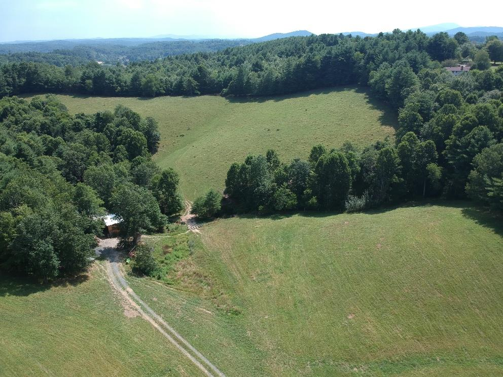 Outstanding 16.6 private acres with good views and the perfect spot to build your new Cabin with great access! Mixture of open hay fields and wooded land that's approx 85% open with a nice creek running through the lower part of the property. Completely fenced for your horses or cattle. Two barns with 4 stalls, tack room and holding pin. Located within minutes of the Jefferson National Forest, New River and New River Trail & Fries.