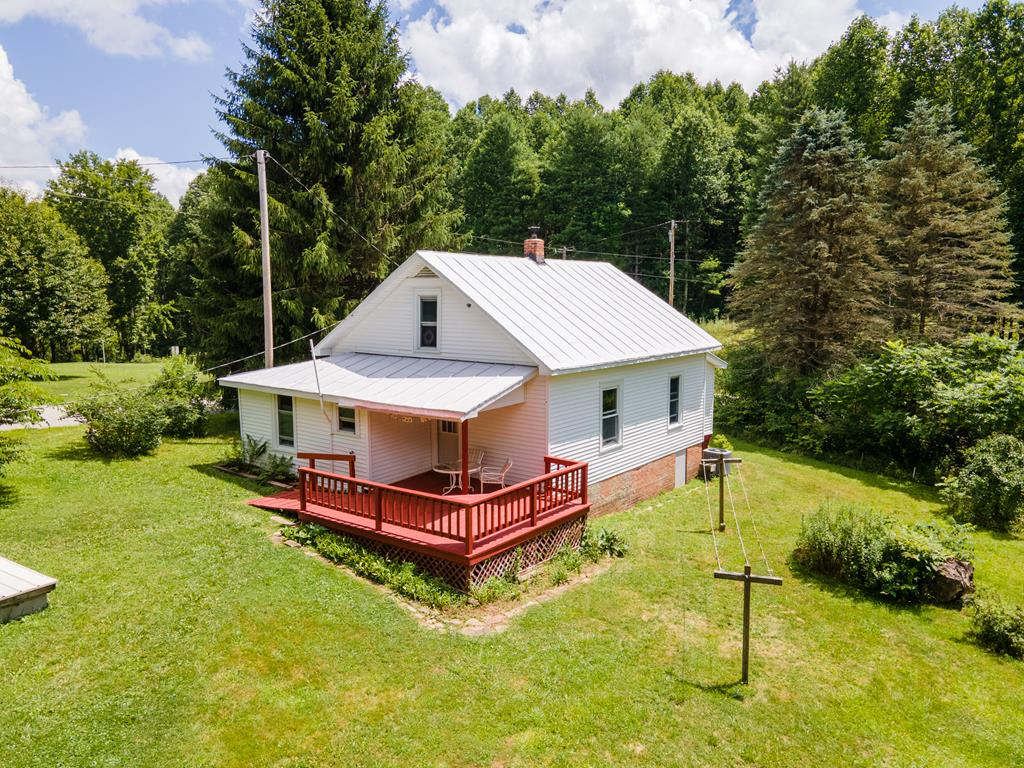 Welcome to lovely Lilac Corner! This charming 3 bedroom, 1 bath, well insulated, Floyd County farmhouse with a spacious 10,000 sq ftfenced labyrinth garden with established, organically grown perennial medicinal plants, flowers, asparagus, fruit trees & room to add more. The property has a couple small field areas & outbuildings for farm animals & workshop. One of the structures has a green house built onto the South side creating a great area to start seeds to prep for the season & hang out in the sunshine in the winter. Items completed in the past 5 years include: newHeat Pump with A/C, well pump & pressure tank, water supply line to house, hot water heater, interior supply plumbing, wood stove, stainless steel chimney liner, new marine coating on roof 2020. Located 1.4 mile from the Parkway close to Mabry Mill & Floyd Fest, 2.5 miles from Buffalo MountainPreserve and in close proximity to wineries. Schedule an appointment to see this beauty for yourself!
