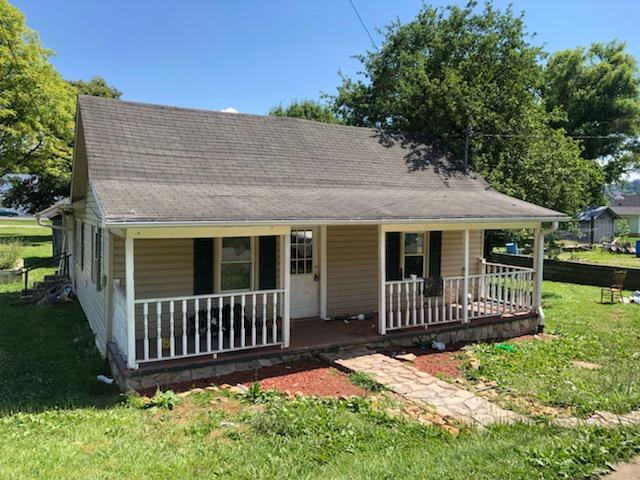 3 BEDROOM, 1 BATH, 1064 SQ. FT. BUNGALOW WITH VINYL SIDING, NEWER ROOF, NEWER WINDOWS, 168 SQ. FT. FRONT COVERED PORCH...ON A CORNER LOT.
