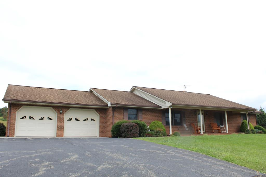 "Beautiful Brick Ranch Style Home with full partially finished basement and2 car garage attachedfor Sell in Floyd, County, VA (2402 Floyd Highway, Floyd, VA 24091). Main Floor: Kitchen (15' x 12'). Dining Area in Kitchen(12'2"" x 12'). Dining Room (11' x 16') Hardwood Floor. Living Room (16' x 15'9"") Hardwood Floor. Laundry Room (6' x 12'2"") Vinyl floor. Foyer (6' x 122'2"") Hardwood Floor. Hallway (3'4"" x 23'9"") with hallway closet. Bath (4'10"" x 8"") Vinyl Floor. Bedroom (12'2"" x 10'10"") Hardwood Floor. Bedroom 13'6"" x 12'2"") Hardwood Floor. Master Bedroom (14'2"" x 12'2"") Hardwood Floor. Master Bath (9'5"" x 4'5""). Front Porch (6' x 34'). Back Patio (21' x 10'). Full finished bath in basement.Ceiling and walls are finished in remainder of basement. Could be converted to living quarters. Wood Burning Stove in the Basement. New Heat Pump in 2019 plus kerosene forced air furnace.."
