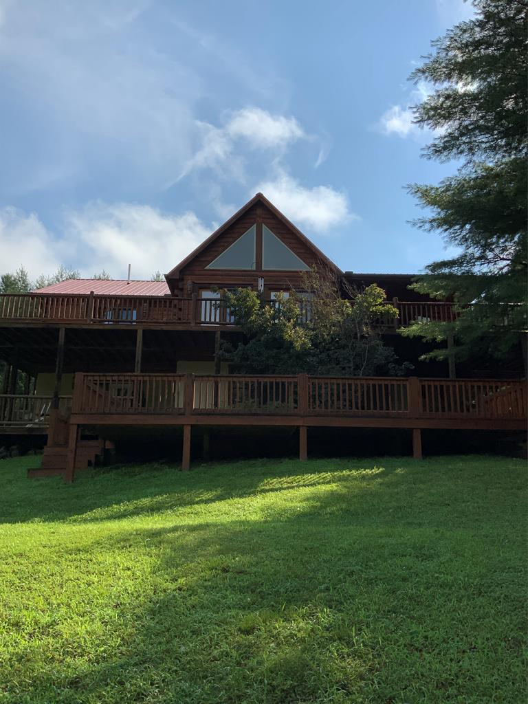 Listed below appraisal value.  VIASAT internet.  Unique log cabin on 2.84 acres with frontage on Crooked Creek.  Well maintained home in gated community.  Private setting.