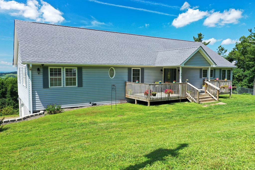 """Awesome country side views! Home features: 3392 sq. ft, 3 BR, 3 BA,  Hardwood flooring, Newer tile and carpet, Huge Living room with gas log or wood burning fireplace. Kitchen has newer appliances and plenty of cabinets, granite counter tops and a 8' x 3""""11 pantry, Large master bedroom with a walk-in closet & bath that features double sinks and shower. Laundry on the main level, 2 more bedrooms on main level, Another bath with jetted tub, 1088 sq. ft finished  with plenty of room for another bedroom /family room or apartment in the basement with another bath. Drive under garage with newer doors. Heat pump with propane, 648 sq. ft of side and back deck to enjoy the sunset and entertaining, Newer 10' x 32' front porch.  Fenced for your pets. Great location, only about 4 miles to I-77 and the Blue Ridge Parkway."""