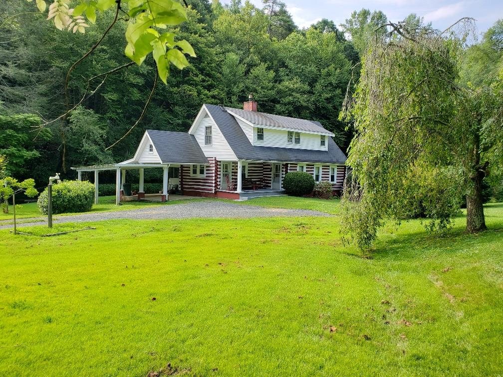 Country living at its best! Mini farm on 4 +/- acres with fenced pasture and a nice creek running the entire distance of the property. Very nice 4 bedroom 1 bath  cabin with barn so bring the animals. Great location within a half mile of the New River.