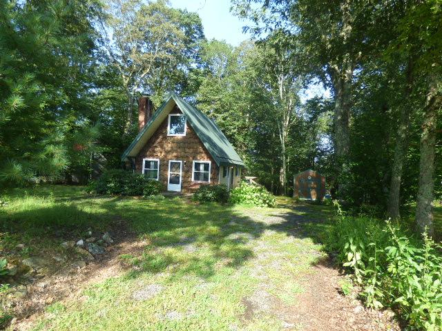 AWESOME cottage off the Blue Ridge Parkway.  Situated on approx. 1/2 acre of unrestricted land., which provides for room to park an RV or other.  Most of the home was upgraded a yr ago, to include new kitchen cabinets, granite, newer appliances, newer flooring, newer plumbing, lighting, decks, a half bath added.  Lots of REAL CEDAR trim, real masonry fireplace.  A HVAC mini split system added.  METAL ROOF , a new storage building is on the property.   This is a nice cottage with much potential for full time living, vacation home or nightly rental.  Location is very convienent.