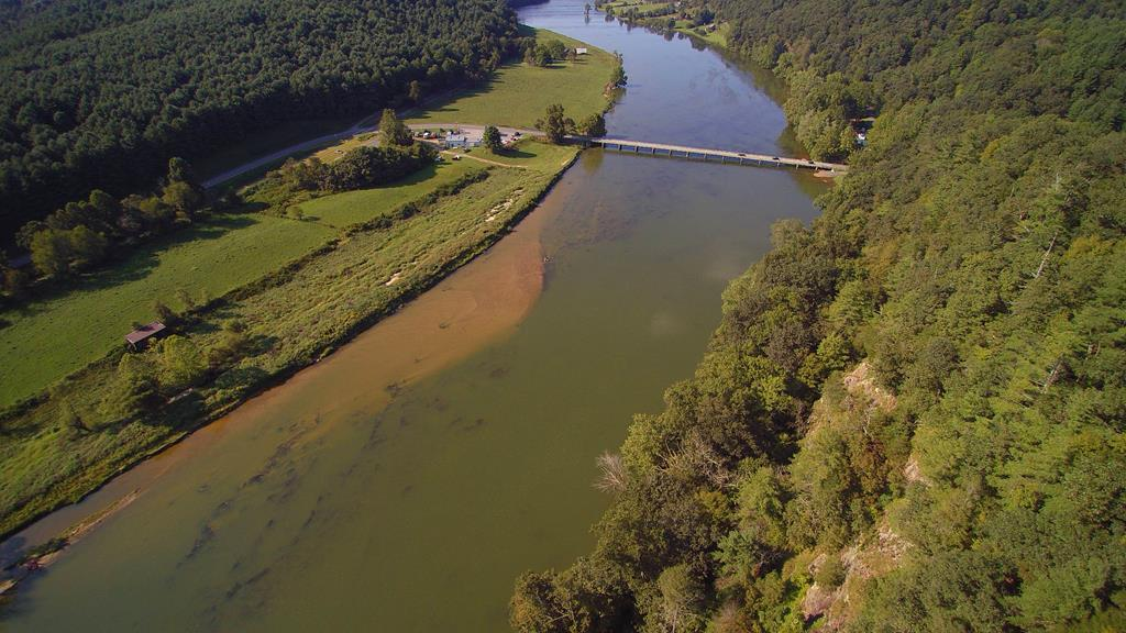 One of a Kind New River View. 23.94 acres overlooking the New River and the town of Fries. This is a supreme view from atop a ridge overlooking the New River with river frontage. Just minutes to river access and the New River Trail. Good access and road frontage. Just minutes to the City of Galax for shopping and restaurants. This is unrestricted property, you can bring your camper or RV.