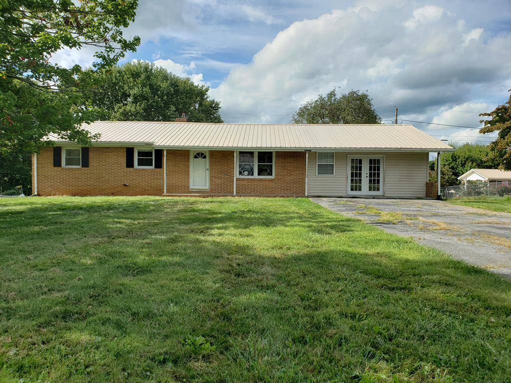 """NEW PRICE -- MOTIVATED SELLER!!!  Nice Brick home with so much space and potential, OVER 1700 SQ.FT. That's only $74.00 per square foot....someone needs to jump on this deal Large Kitchen -Dining combo,  a den with fireplace, LR, 3 BR 2 bath on the main level.  The basement offers so much potential for expanding!  Some updating.  Hardwood, vinyl floors.  Nice lot in a nice neighborhood near Holston High. Selling """"As Is"""" Buyer can home inspection for their benefit only  If there are any blinds, or hardware are as is"""