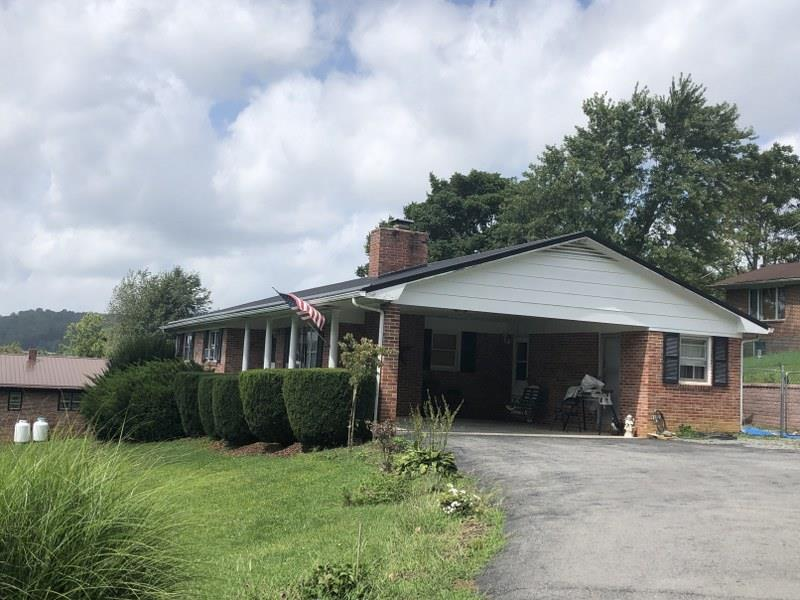 Nice brick ranch in convenient location. House has many updates throughout. Hardwood, Ceramic tile and laminate flooring. 1 car carport, metal roof, 2 utility rooms, 2 gas fireplaces. Storage building with electric. Copper plumbing and crawl space.