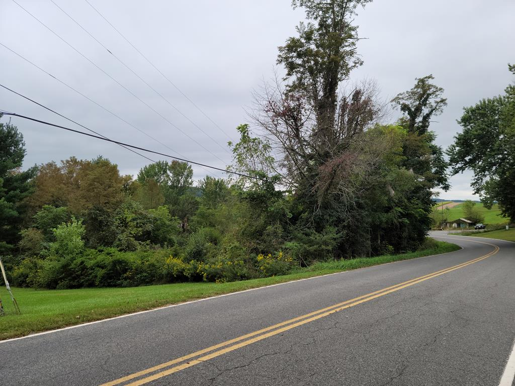 Nice building lot in a quiet, country setting. Close to schools and towns. Interstate close by. Slightly sloping with view. Public water available for this property but will require septic system.