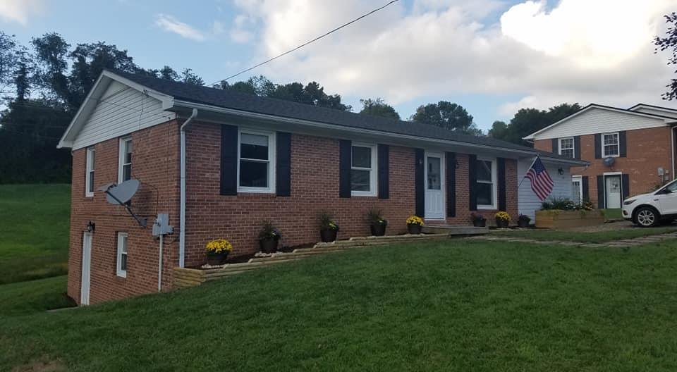 Recently updated brick ranch on a quiet street in Hillsville.  The first floor features a  large master suite, open concept living room/dining room/kitchen and 2-3 additional bedrooms and another bath.  With a heat pump and replacement windows, all you have to do is move in and enjoy life!
