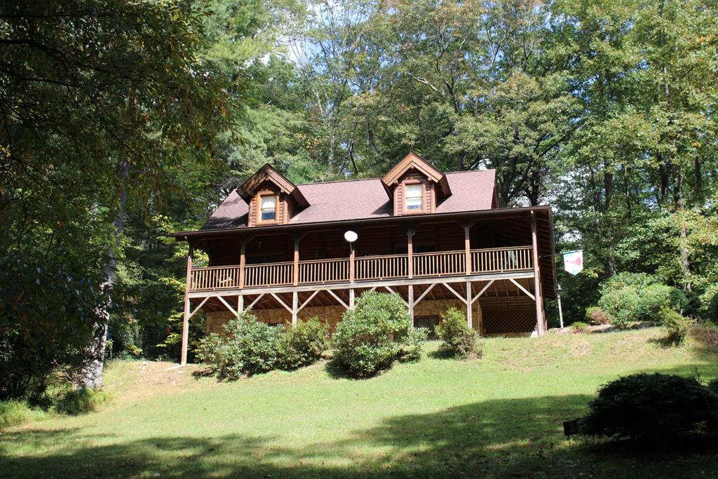 Enjoy this well built log cabin in Cascade Mountain Resort. Home features: 2665 sq. ft., 3 bedrooms, 3 baths. On the main level you have a living room with a gas log fireplace, kitchen with the appliances conveying, dining room, bedroom, bath and laundry. On the upper level you have the master bedroom, bath with jetted tub and a spacious loft. Lower level is a family room, another bedroom, bath and utility room. Heat pump. Home has easy access to the main level and the 576 sq. ft of covered porch.  Paved driveway. Amenities include: Swimming pool, fishing pond, play ground, trash area, community water, tennis courts and a clubhouse. Located less than 5 miles to I-77 in Fancy Gap.