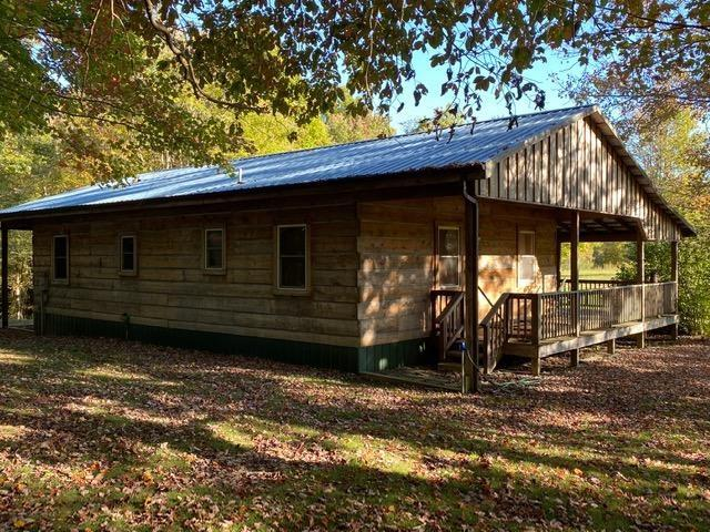 74 Beautiful Rolling Acres with a cozy 2BR/1BA Cabin tucked away and off the beaten path in Elk Creek, Va.   Private and Peaceful.  Land is partially Wooded and Partially open with Lots of Streams and Springs Throughout.  Beautiful Views, a Pond with a Dock and a Gazebo, a 12x10 Shed and a 24x24 Barn.  The Cabin is Made of Hemlock Wood, and has 2 Bedrooms/1 Bathroom, plus a sleeping loft that all the kids will love.  Huge Open area that Includes the Living Room area, Dining Area, and Open Kitchen.  Wood Stove and Propane Logs are the Sources of Heat, and  at @3200 ft elevation, you don't really need A/C.   Property is set up Perfectly for Hunting or ATV Riding, or Just Enjoying the Outdoors and all that Nature has to Offer.   Can be Purchased Fully Furnished with the Right Offer.