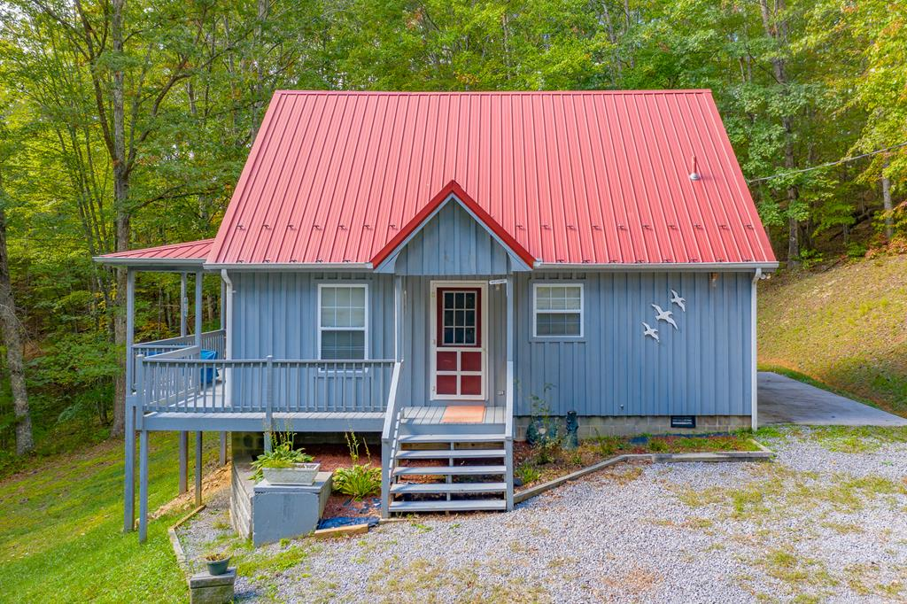Extremely cute 2 BR 1 BA fully furnished cabin on +/-2.1 acres in Bland County, VA. Built in 1998, the cabin has hickory wood siding, a metal roof, wood stove for heat, window unit for cooling upstairs, parquet, tile, and vinyl flooring, refrigerator, oven, and washer, insulated tilt windows, and a partial unfinished basement. Other features include an open patio, covered front porch, outbuilding and sheds, and a private well and septic. Complete privacy with trees surrounding the cabin!  Property borders Jefferson National Forest which would make this a great hunting getaway and nearby you'll also find Wolf Creek Golf & Country Club.
