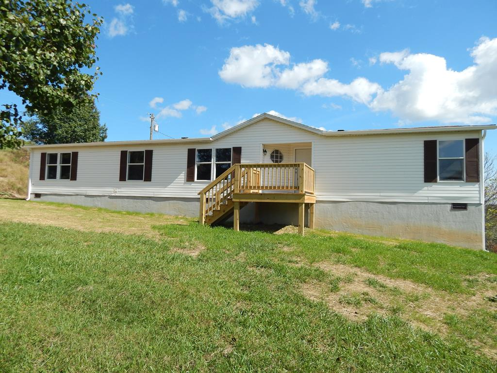 JUST REMODELED FROM TOP TO BOTTOM! 4 BEDROOMS, 2 FULL BATHS, LIVING ROOM WITH A GAS FIREPLACE, UTILITY ROOM, SPACIOUS KITCHEN WITH ALL NEW STAINLESS STEEL APPLIANCES, DINING ROOM, NEW FLOORS, NEW PAINT, NEW FRONT PORCH, NEW DECK, HEAT PUMP. CLOSE TO SCHOOLS AND SHOPPING.