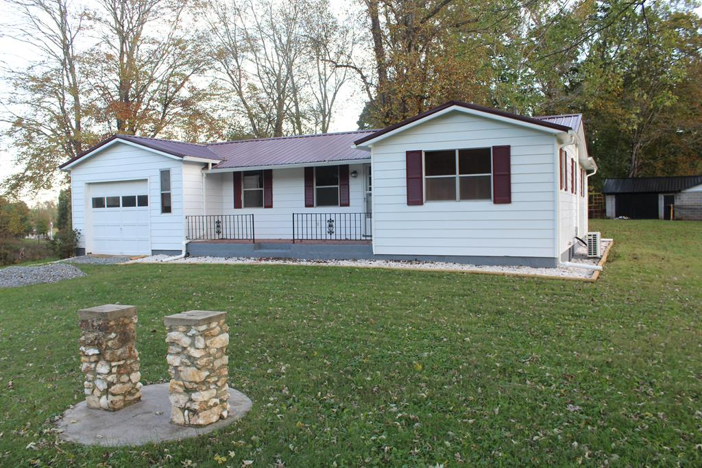 """Ranch Style Home with partial basementand 12.79 acreslocated in Patrick County, VA (2714 Mill House Road, Woolwine, VA 24185). Main level: Kitchen-Dining Area(11'2"""" x 15'6""""), Living Room (12' x 15'4""""), Bedroom (9'4"""" x 10'8""""), Bedroom (7'9"""" x 11'9""""), Bath (9' x 5') and Bedroom (13'8"""" x 15'3""""). New wall heaters in each room.Door from Kitchen to back porch (5' x 18')and basement. Partial basement: (Washer and Dryer in basement, woodstove in basement and 1/2 bath(up flush commode and sink in basement) New Heat Pump. Front porch (6' x 19'6""""). New Roof. New Plumbing and several additional improvements.Fronts on State Paved Road. Graveled Driveway. Private. Workshop-garage (22' x40') Block building with metal roof with addition on back (22' x 8'). Basement under workshop (10' x 20'9""""). Equipment shed (16' x 30')."""