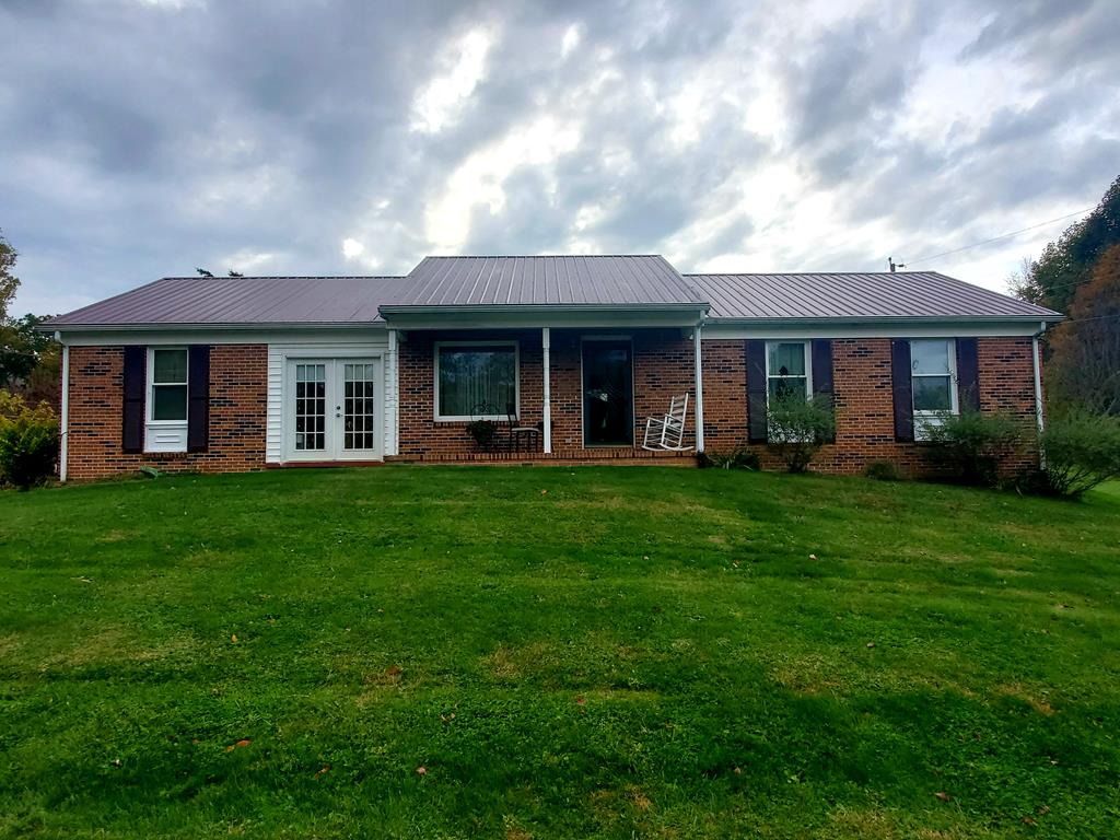 Check out this charming brick ranch that gives you the feeling of being in the country while only being minutes from town.  This home has a newer metal roof and windows along with an extra lot that is located right across the street from the home.  This would make an excellent starter home or a perfect home for families looking to downsize.  There is an attached garage area that gives lots of extra storage room. This home has lots to offer and is a must see!!