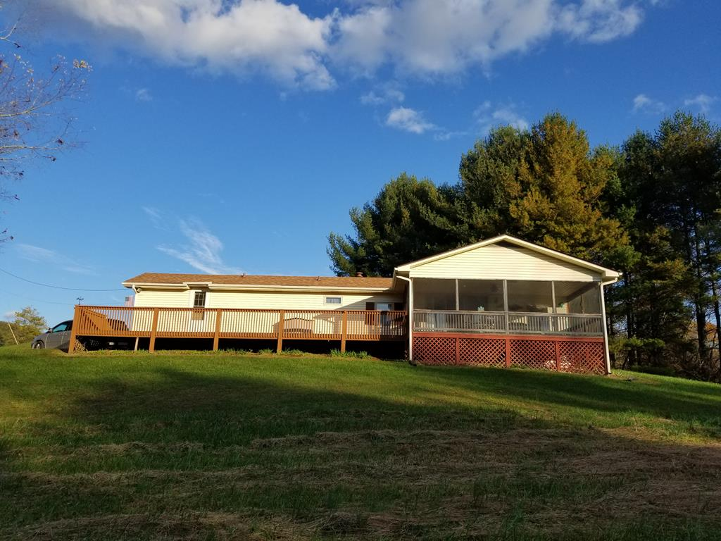 Leave your stress behind when you come to this renovated 3 BR, 1 1/2 bath single wide with 4.18 acres. Nice rolling land with beautiful mountain views.  Wonderful view of Kindreck Mountain from the screened in porch at this weekend getaway or could be used as a primary home.   Land lays well and it comes with another trailer located near main dwelling.