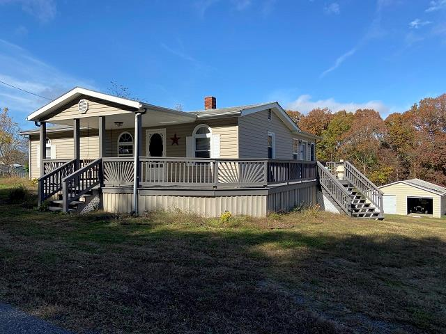 Investment Property! Nice 2 bedroom 2 bath home with updated kitchen, hardwood floors and heat pump. Great starter home with rental income.