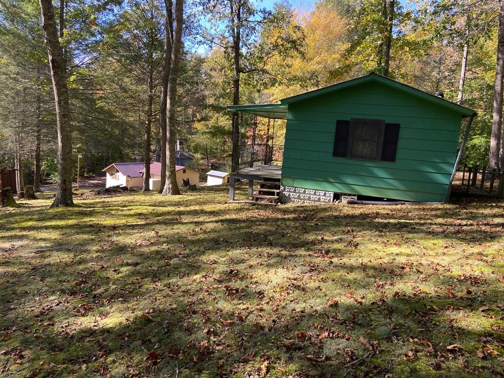 ATTN: HUNTERS, NATURE ENTHUSIASTS AND NATURE LOVERS! Ever wanted to get away -- I mean REALLY GET AWAY?  I have the perfect place and it BORDERS Jefferson National Forest!!!  Not one but TWO cabins on three lots!  Walk to HUNT or FISH in a stocked trout stream.  These cabins are less than TWO miles from the Appalachian Trail!  The property is beautiful and quiet - Nature truly abounds with wildlife - deer, turkey, bear!  No electricity but has generator connections on each cabin.  Two sources of heat - wood/coal stove or propane wall heaters!  A drilled well provides water.. No internet service and no cell phone service. There is a shared drill well and it is shared with these two cabins only.  The first cabin is a 3-room cabin - living room, kitchen and bedroom. The bedroom has carpet. There is a 150 cistern tank inside the building that holds the water from the well and supplies the larger cabinet. The roof on the larger cabin was replaced in 2013.