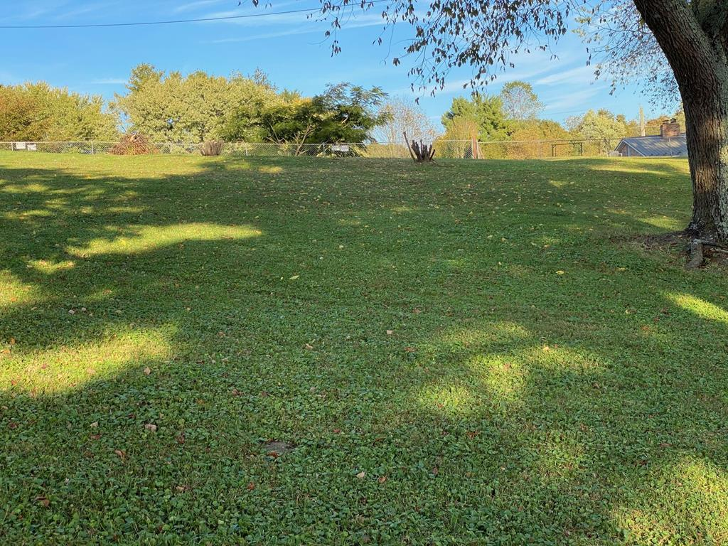 VERY NICE BUILDING LOT OUTSIDE TOWN LIMITS OF MARION IN HALL ADDITION. CLEARED AND READY TO BUILD OR PLACE A DOUBLEWIDE, TRIPLEWIDE OR MODULAR HOME (NO SINGLEWIDES). WATER AND SEWER ARE AVAILABLE AT THE ROAD; GREAT VIEW OF MOUNTAINS (LIMITED).