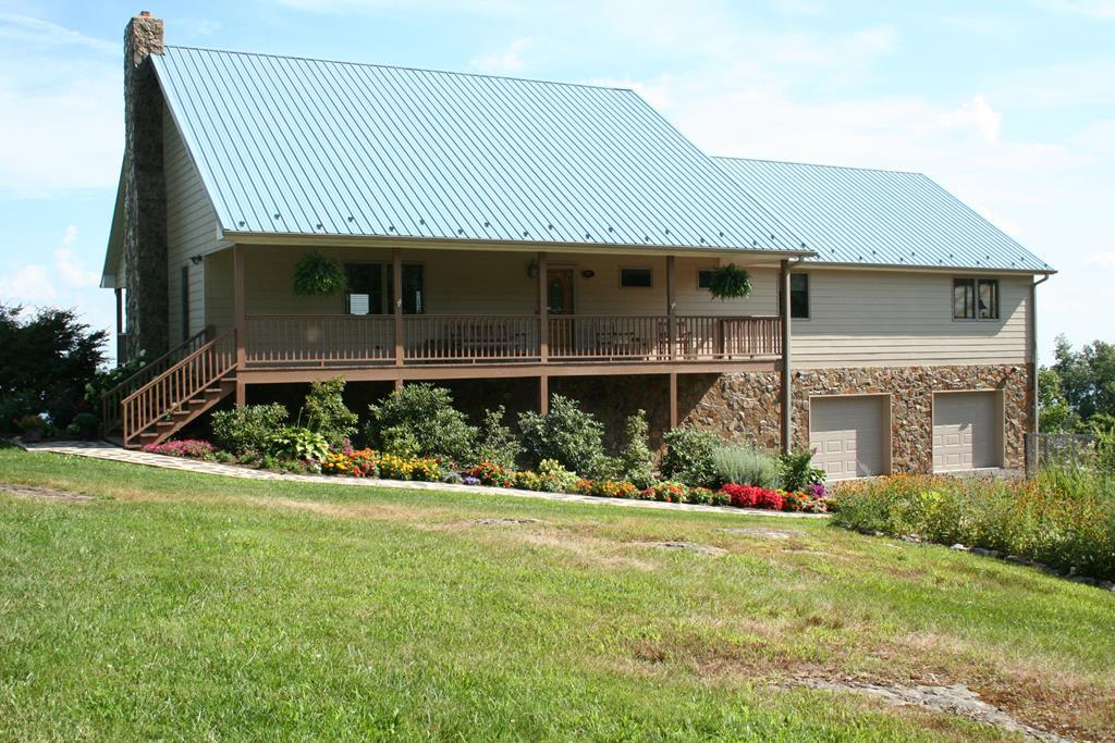 """3.66 acres with a Piedmont View home right off the Blue Ridge Parkway. Home features: 3750 sq. ft., 2 Bedrooms, 3 Baths, Open floor plan with a stacked stone gas log fireplace, tongue and grove pine ceilings and walls, tile flooring, Bose sound system with speakers & Yamaha receiver with remote speakers in master bedroom & deck. Large flat screen TV also conveys. Dry bar with ice maker, glass door cabinets and marble counter.  Beveled mirror glass divider in entry hall. Kitchen features: granite counter tops with tile back splash, 48"""" stainless steel Viking commercial gas range with double ovens, grill,  griddle and a Broan hood propane stove. Over-sized refrigerator. Large L-shaped island which seats six and has a prep sink. Garbage disposal. Bay window looking over the Piedmont and access to the rear porch. Large walk in pantry. Laundry room has extra cabinets, shelving and freezer is included. Bath with jetted tub. Enjoy your own study with a built in desk, bookcase,"""
