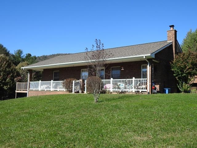 Spacious Brick Ranch home in the Fries community. This home features 5 bedrooms, 3 baths, laminated hard wood flooring, tile floors, main level laundry and much more! Enjoy the beautiful mountain views from the back deck. This home is a must see!