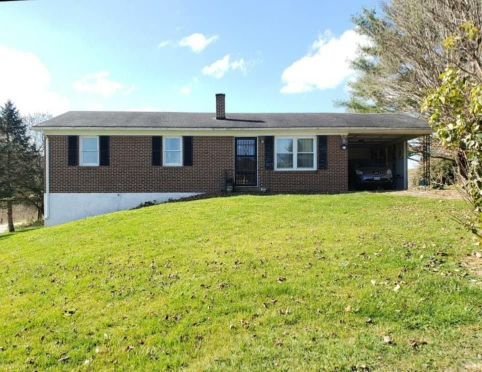 Don't miss the opportunity to own this 3 bedroom, 1 bath, brick ranch!  Only 1.5 miles to I-77, the location is convenient but still far enough out to enjoy gorgeous, countryside views.  On the main floor you'll find a galley kitchen which is open to the dining room, a large living room with great natural light, 3 bedrooms and a bath.  The full unfinished basement can be accessed from inside or outside the home.  You can easily double your living space by finishing the basement!  Kitchen appliances, washer, dryer, woodstove, and outbuilding will stay.  Home is listed at tax assessed value!