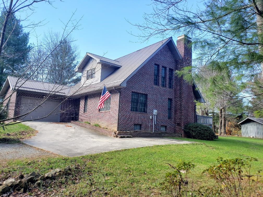 Country Living at its best! Very Nice Quality Built Brick home situated on 1.4 acres on a quiet street within minutes of the Blue Ridge Parkway and down town Galax. Large open floor plan in the living/dining area  with brick fireplace.  Bedroom, Bath and Laundry room on the main floor.  2 bedroom and bath on second level, Walkout basement and Garage. Enjoy the privacy from the large back deck. Beautiful open and wooded lot with apple trees and garden area.