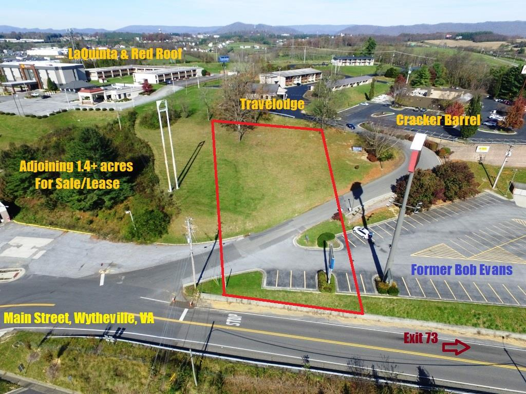 Location along I-81 & I-77 Exit 73 commercial development opportunity. With over half of an acre above Lithia Nye Road, that leads to Cracker Barrel and Travelodge Hotel, this property has potential to be visible to every vehicle exiting onto E Main Street, Wytheville, VA. With adjoining acreage also available, the combination could be one of the largest tracts on this exit for hotel, restaurant, gas station or other commercial enterprise. With frontage on Lithia Road and Lithia Nye Road, there's plenty of room to advertise!