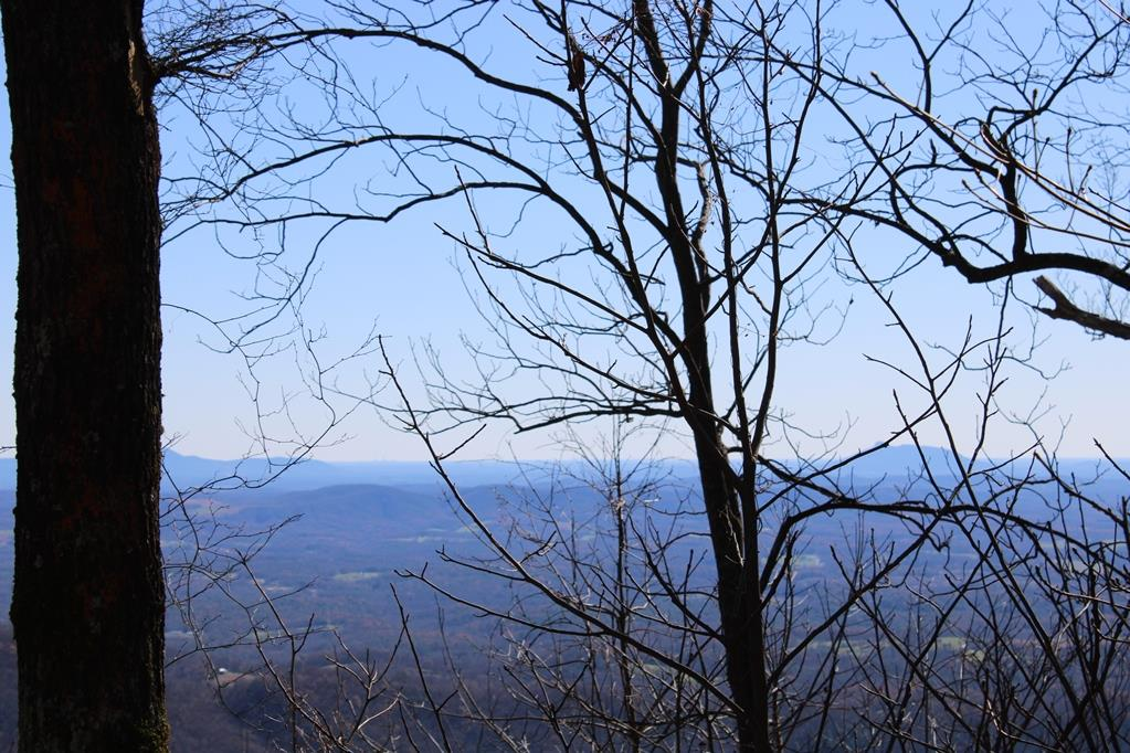 60 mile Piedmont View lot in Seven Springs Development. Land features:3.57 acres, Great building site that sits back off the road. Underground power. Beautiful views! Restriction and yearly road dues. Located only 7 miles to Hwy 52 and I-77 in Fancy Gap VA.