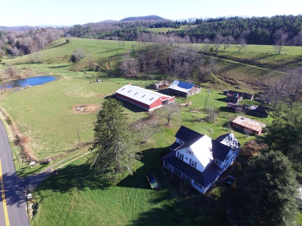 Historic farmhouse on 33+ acres of equine property near recreational properties and horse trails. With spring fed pond and creek flowing throughout the property, the open acreage is well fenced and is supported by a 5,000 sf horse barn and multiple pastures for grazing. The property has other historic barns and buildings to support the farming operations and with plenty of road frontage, the options to divide is a possibility. Step back in time in the spacious farm house with beautiful hardwood flooring and custom woodworking throughout and with large rooms and 4 total bedrooms and 2 full baths coupled with library, attic and full basement for lots of storage options. Recent improvements include furnace, metal roofing, septic tank and insulated windows. Bathrooms are spacious and laundry is on first floor with plenty of gathering space throughout the home and within the front and back porches.Come explore options at a short distance of recreational opportunities and horse trails