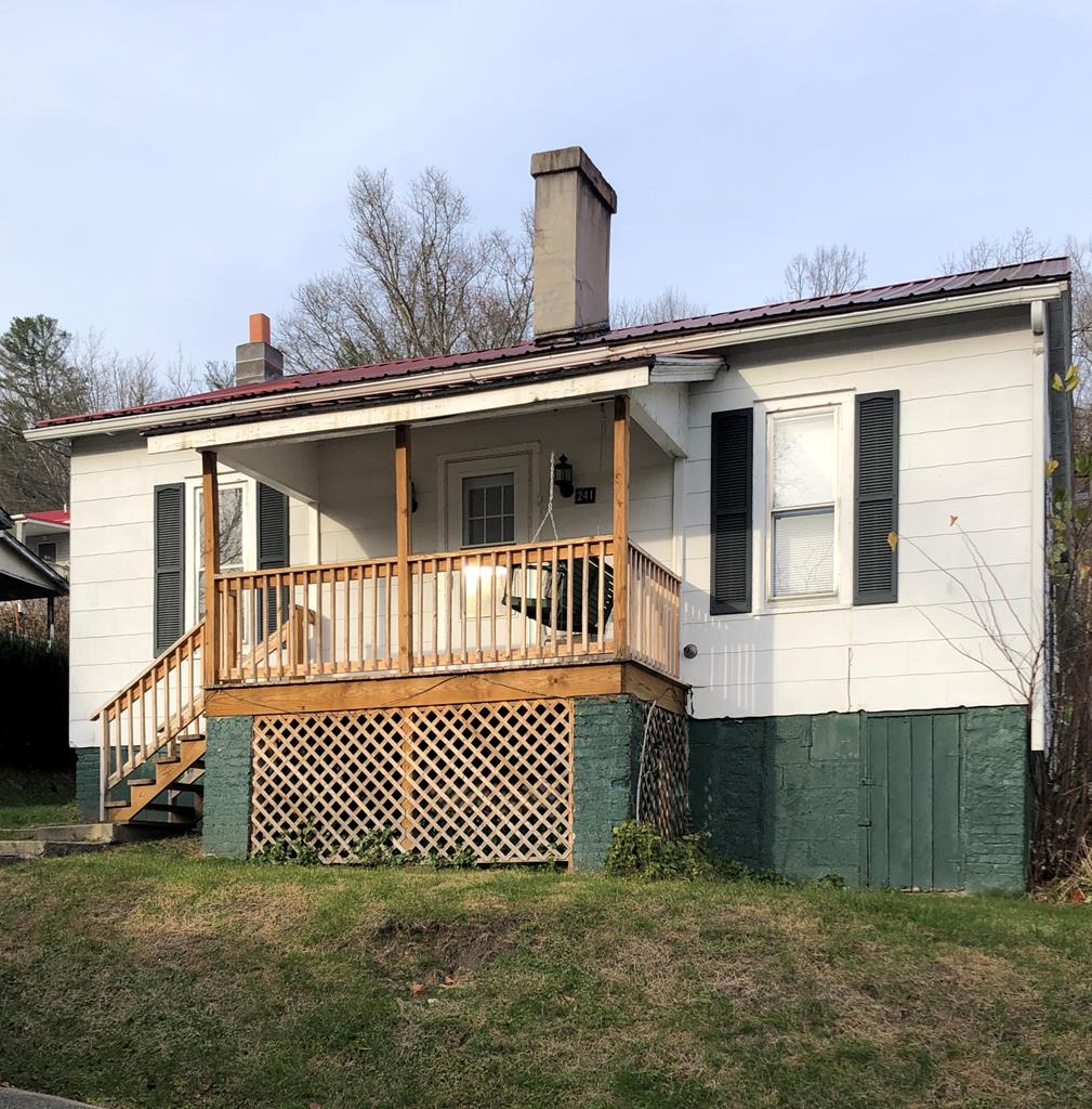 Looking for an affordable first home or vacation property? Here it is, located in the heart of the quaint town of Fries, VA! The New River, New River Trail, school, Town Hall, theater, and recreation center and the new Farmer's Market are all only a five-to-ten minute walk away. This house has newer stairs/front porch, paint, water heater, and refrigerator, plumbing updates, new flooring and tile in the bathroom, gorgeous new hardwood flooring in one bedroom, new carpet in the other. Original 100+ year old hardwood floors in at least the living room and under the bedroom carpeting. Vintage metal kitchen cabinets. Oil monitor heat. Laundry hookups on the enclosed back porch.Walk-in basement/crawlspace with plenty of storage space for your bikes and kayaks! Buyer & Buyer's Agent to determine Internet availability.While Seller has no knowledge of material defects, home is selling AS-IS,Seller to make no repairs. Inspections at Buyer's expense/for informational purposes, only. Owner/Agent.