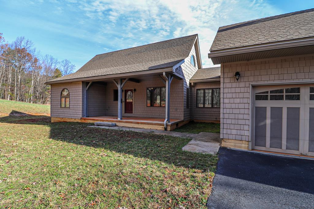 Custom timber frame home with vaulted ceilings throughout. Features 3 bedrooms and 2.5 baths. Quiet rural setting with paved driveway and double attached garage. Full walk out basement with plenty of storage space.