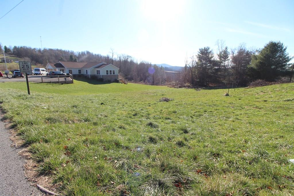 Buildable land on about .78 acre. Land is on corner lot and has really nice views on two sides. Located on state maintained paved road access. Land slopes gently and is mostly cleared. Located in Hillsville and surrounded by a variety mix of homes. This is being sold as land only. The home is a complete tear down. There is public water and power. The old unlivable home was a 4 bedroom with 1.5 bath if that helps a buyer decide on size of home appropriate for this 3/4 acre land being sold. I included photos of the home also, so buyers can see what needs to be torn down. The buildable areas of this nice size affordable property lends itself to be placed overlooking the front/side/rear mountain views. Although the home is unlivable, the land is actually quite nice and the views were a pleasant surprise. Land is easy & quick access to all shopping, schools, work commutes from here would be a great central location. Just a few minutes to I-77, quick to 58 and 52 as well as Floyd Pike.