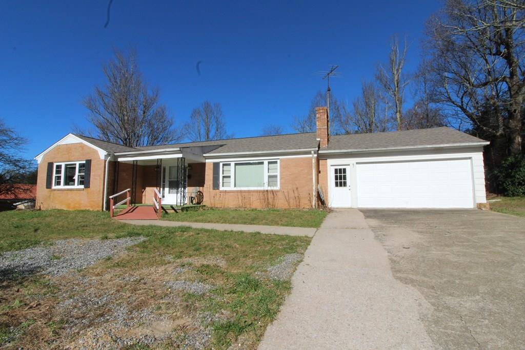 Brand new roof, brick ranch, 3 bedroom, 2 full bath, all hardwood floors, ceramic tile in bathrooms, large open living room that flows into the dining room. Double attached two car garage with overhead garage door opener to walk right into the kitchen for easy access and safety in all four seasons. Double driveway and large level rear yard with storage shed. Perfect place for first time home buyers to raise a family. Plenty of level land to play games, entertain family and friends and let the kids run around & play. The basement is unfinished and has interior entry and exterior entry. Kitchen has range hood, electric range oven, dishwasher and refrigerator. There are 2 fireplaces. One upstairs in living room is gas logs. One in the basement has never been used by current owner. Brand new public water and sewer hooked up Oct. 2020. There is a bathroom hookup in the basement. Laundry area hookups in the basement also. In Fancy Gap at Blue Ridge Pkwy entrance. Easy to Hillsville, Mt Airy,