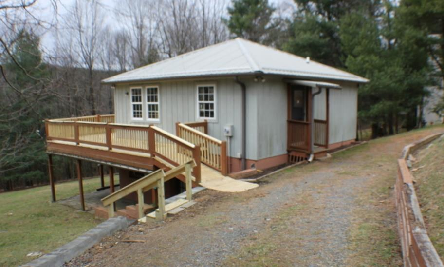sELLERS HAVE ACCEPTED AN OFFER NOW WAITING ON PAPER WORK.  Delightful mountain cottage with a great room (includes living area, kitchen, dining area, and small office area) with windows and front door on the main level and three bedrooms plus a full bath on lower walk out level. The Cascade Mountain community is a neat mountain gated community with club facilities and is located just off the Blue Ridge parkway in Fancy gap Virginia with scenic views and recreational activities . Streets are maintained by the Home Owners association along with the club house and common areas. If you are looking for a quiet mountain retreat for weekend getaways or a permanent home this is it. Call to see it today.  Owner is selling property as is where is with no guarantees or warranties.