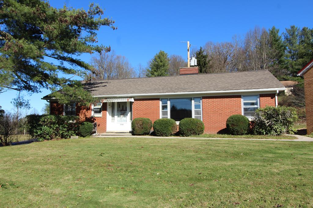 Located at the Blue Ridge Parkway in Fancy Gap, sprawling brick ranch home w/3 bedroom, 1.5 bath, sitting at the Blue Ridge Parkway entrance. Huge open living room that flows into the dining area. Master bedroom has nice half bath. Two additional large bedrooms just off hallway with huge 7x10  full bathroom w/separate dressing vanity, tub/shower and lots of room. The home is served by public water and public sewer. The home has beautiful original knotty pine walls that are in stunning condition. The home is all brick exterior, shingle roof, has nice front courtyard area. The galley style kitchen lends itself to plenty of great meals to be prepared. This home has been used part time by current owner. The home has its own separate tax card but could be used as the home place for someone who buys the business property next door. Many options for those who are looking to own their own home & business. Just 15 min Mt Airy, 10 min Hillsville, 90min Charlotte, 1 hr Winston. Easy commuting.